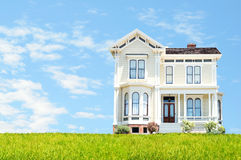 Beautiful house. Against cloudy blue sky background with the room for your text Stock Photo