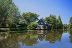 Beautiful house along a river stock photography