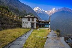 Beautiful House and background Annapurna Mountain. Beautiful Traditional Nepali House and background Annapurna Mountain Chomrong Village Nepal. on the way stock image