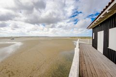 Beautiful house in the basin of Arcachon. Beautiful black wood house on stilts in the basin of Arcachon on the island with birds Stock Images