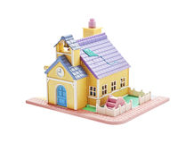 Beautiful house with a children's slide on a white stock images