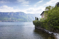 Beautiful house close the lake. A beautiful house really close to the lake surrounded by green trees and plants in Bellagio, Italy royalty free stock image