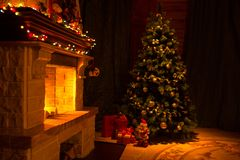 Beautiful house decorated for Christmas interior with fireplace stock photo