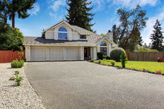 Beautiful house exterior with curb appeal. Luxury house exterior with tile roof. House with three car garage and front yard landscape Stock Photography