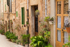 Beautiful house facade with flowers. Beautiful house facade on street with flowers Stock Images