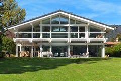 Beautiful house with garden. Facade of a beautiful house with green garden, summer day stock photography