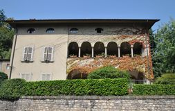 The beautiful house with a green fence. In Bergamo  on a clear summer day Stock Photography