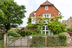 Beautiful house with green garden seen in Rye, Kent, UK. Royalty Free Stock Images