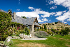 Beautiful house on a hills. Beautiful house in an outskirt of Queenstown, Central Otago, New Zealand stock image