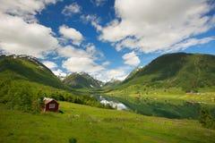 Beautiful house in idyllic landscape Stock Photos
