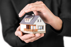 Beautiful house in mans hands Stock Images