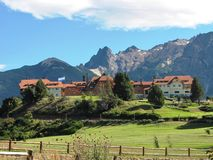 Beautiful house in the middle of nature and surrounded by mountains in San Martin de Los Andes, Argentina. Royalty Free Stock Images