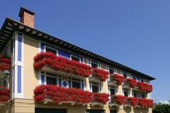 Beautiful house in Navarra with flowers on balcony Royalty Free Stock Images
