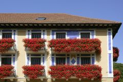 Beautiful house in Navarra with flowers on balcony Royalty Free Stock Image
