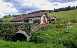 Beautiful house over a medieval stone bridge in Pais Basco, Spain, on on Camino de Santiago route along the Northern coast of. Beautiful house over a medieval royalty free stock image