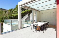 Beautiful house, patio. Beautiful house, modern style, view from the patio Royalty Free Stock Photos