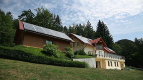 Beautiful house with solar panels on the roof stock footage