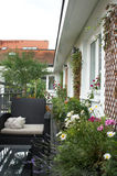 Beautiful house terrace with a lot of flowers Stock Photography