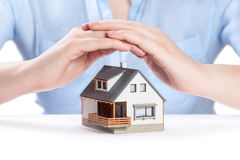 Beautiful house under woman's hands Stock Images