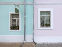 Beautiful House. Wall with windows. Modern iron-shod windows on coloring wall Stock Photo