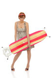 Beautiful house woman with ironing board table Stock Photos