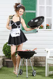 Beautiful Housemaid Keeps Lid And Metal Blade Near Country House Stock Images