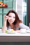 Beautiful housemaid preparing Coffee Royalty Free Stock Images