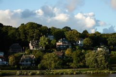 Beautiful houses on a hill near the river Elbe in the city of Hamburg Royalty Free Stock Images