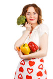 Beautiful housewife with a bunch of vegetables Stock Photography