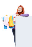 Beautiful housewife carrying laundry basket full of dirty clothe Royalty Free Stock Photos