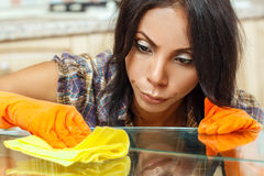 Beautiful housewife cleaning table Stock Photography