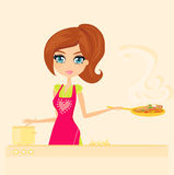 Beautiful housewife cooking Royalty Free Stock Image
