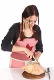 Beautiful housewife cutting chicken Royalty Free Stock Image