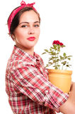Beautiful housewife with flower pot Stock Photo