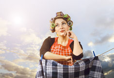 Beautiful housewife hanging clothes Stock Photo