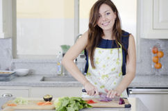 Beautiful housewife making a salad Royalty Free Stock Photo