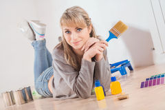Beautiful housewife painting at home Royalty Free Stock Photo