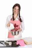 Beautiful housewife preparing with kitchen mixer Stock Image