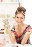 Beautiful housewife with purse and money Royalty Free Stock Images
