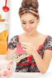 Beautiful housewife with purse and money Royalty Free Stock Photography