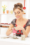 Beautiful housewife with purse and money Stock Photo