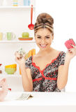 Beautiful housewife with purse and money Stock Images