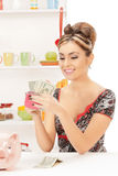 Beautiful housewife with purse and money Stock Photography
