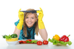 Beautiful housewife in rubber gloves with a knife  Royalty Free Stock Image