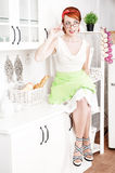 Beautiful housewife sitting on the kitchen table Stock Photo