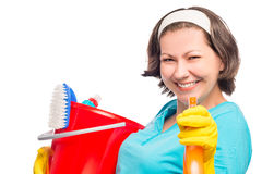 Beautiful housewife smiling directs the spray Royalty Free Stock Image