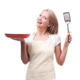 Beautiful housewife with spatula. Isolated on white background Stock Photo