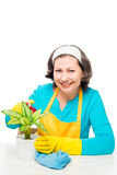 Beautiful housewife takes care of a flower in a pot Royalty Free Stock Photos