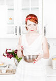 Beautiful housewife with utensils Stock Photography