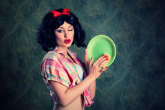 Beautiful housewife washing a plate Stock Image